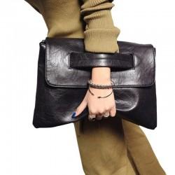 Elegancka skórzana listonoszka, którą można nosić w ręce oraz na ramieniu -