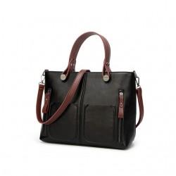 Damska torebka w stylu retro, szyta na miarę każdej okazji. Kolor czarny z brązowymi dodatkami ubarwi Twój codzienny out