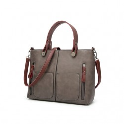 Damska torebka w stylu retro, szyta na miarę każdej okazji. Szary kolor tej torebkiozdobi Twój wyjściowyubiór. -