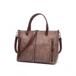 Damska torebka w stylu retro, szyta na miarę każdej okazji. Niezwykle modny kolor torebki - brudny fiolet - doda ekstraw