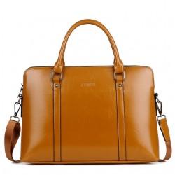 Brązowa elegancka torebka na laptopa. -