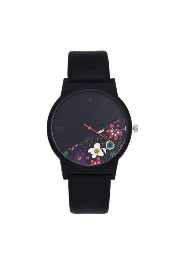 Zegarek damski z tarczą w kwiaty, subtelny i elegancki na pasku skórzanym. -