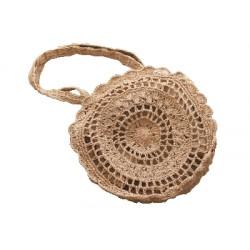 Pleciona torebka z słomy pozwoli Ci wyróżnić się podczas spacerów po plaży -