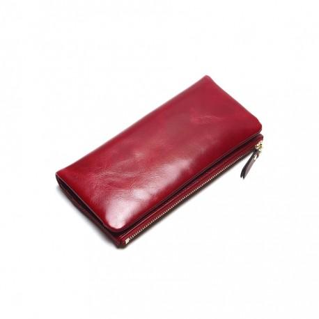 7f1a30e53a71c Wykonany z skóry naturalnej wyjątkowy portfel damski w kolorze czerwonym. -